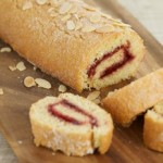 Raspberry swiss roll with almonds